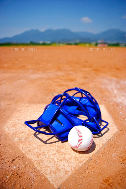 Baseball helmet and ball on home base