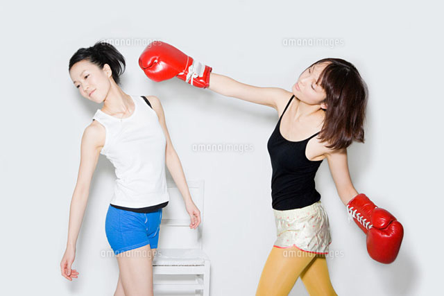 Young women boxing