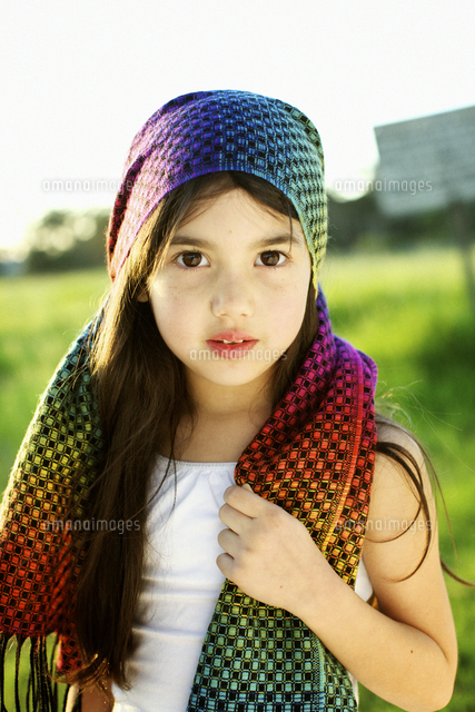 Mixed race girl wearing colorful headscarf