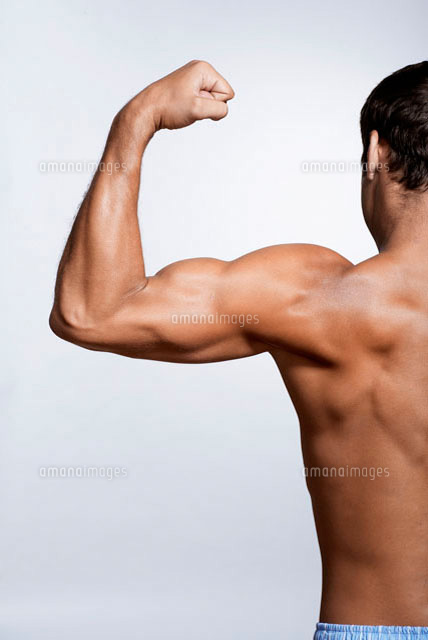 Mid adult man flexing biceps