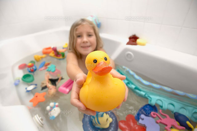 Girl in Bath Holding Rubber Duck
