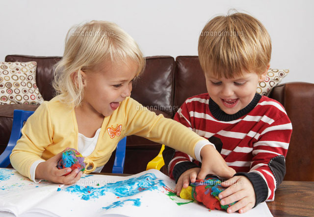 Children Playing With Plasticine