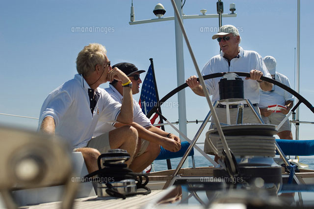Sailors talking at Helm on Yacht