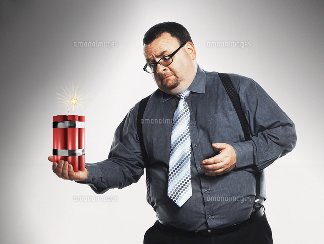 Businessman holding sticks of dynamite