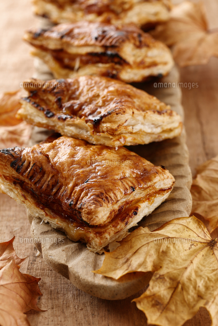 Apple pies with puff pastry and autumn leaves