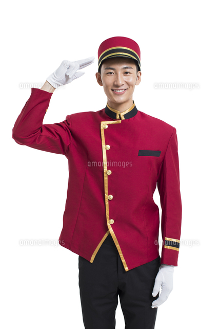Young Chinese bellboy saluting