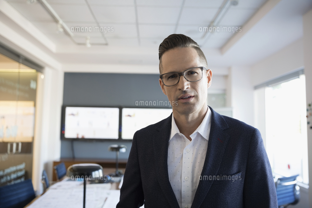 Portrait confident businessman in conference room