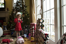 Girl standing by Christmas tree at home 11100060065| 写真素材・ストックフォト・画像・イラスト素材|アマナイメージズ