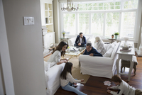 Multi-generation family hanging out in living room