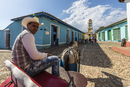 A horse-drawn cart known locally as a coche in Plaza Mayor, in the town of Trinidad, UNESCO World Heritage Site, Cuba, West Indi