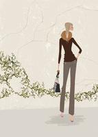 初冬の石壁の前でゼブラ柄のバッグを持ちたたずむ女性 02674000006| 写真素材・ストックフォト・画像・イラスト素材|アマナイメージズ