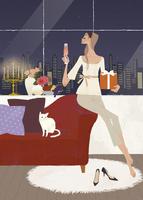 クリスマスパーティを猫と一緒に楽しむ女性 02674000007| 写真素材・ストックフォト・画像・イラスト素材|アマナイメージズ