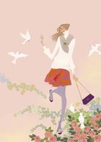 春の花の中で鳥と戯れる女性 02674000039| 写真素材・ストックフォト・画像・イラスト素材|アマナイメージズ