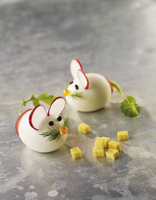 Boiled egg mice with radish slices for ears